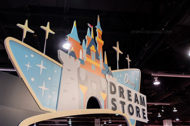 """A massive cartoon castle is featured on a sign reading """"Dream Store"""""""