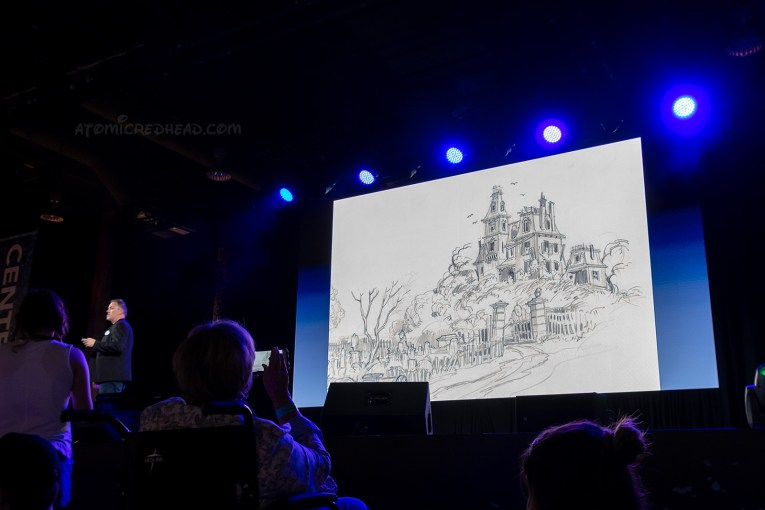 Christopher Merritt presents a panel on the Haunted Mansion and shows the very first concept art of the Haunted Mansion, which is a dilapidated Victorian.