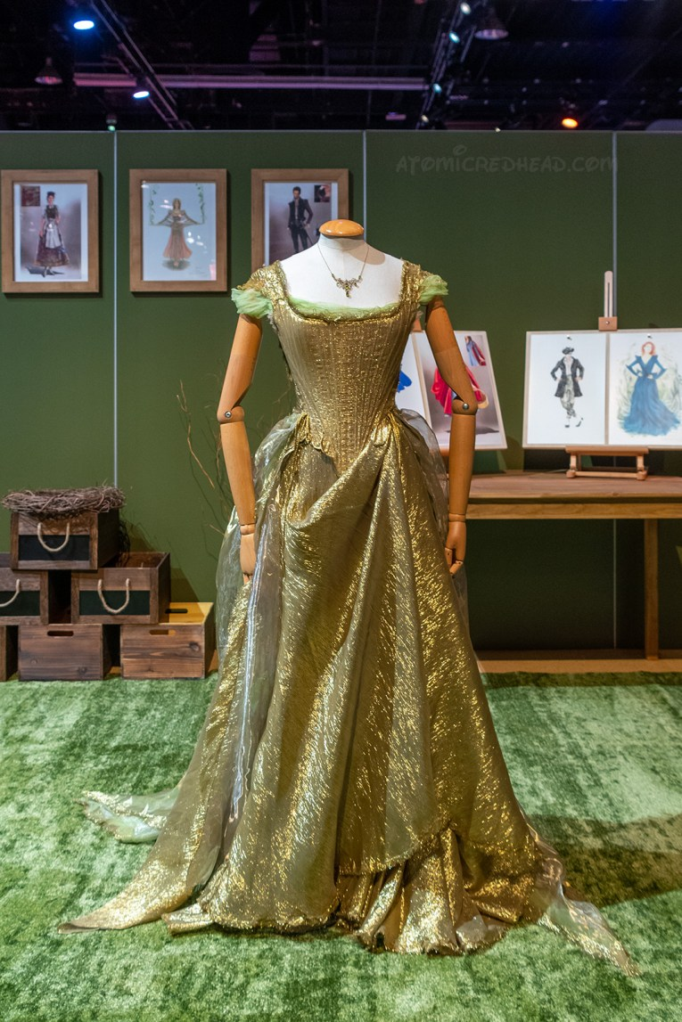 Cinderella's gown from Into the Woods, which is not very full, and gold. It features gathered cap sleeves.
