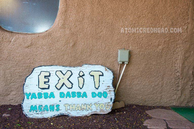 """Exit sign reads """"Exit Yabba Dabba Doo means Thank You"""""""