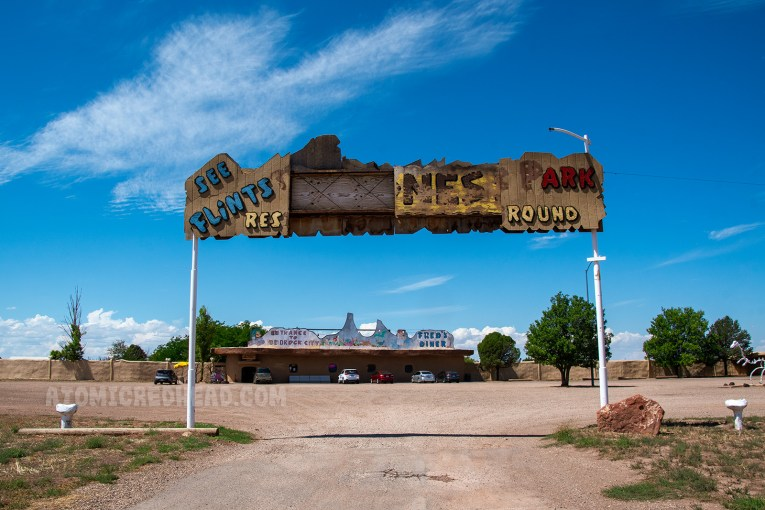 The partially broken sign over the gateway to Bedrock City.