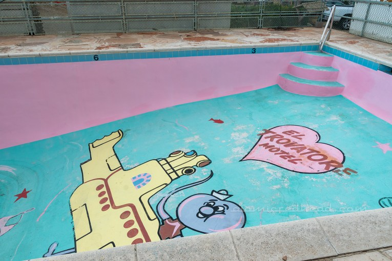 "The pool, while empty, features a yellow submarine mural, with a cartoon octopus coming out of it. A pink heart reads ""El Trovatore"""
