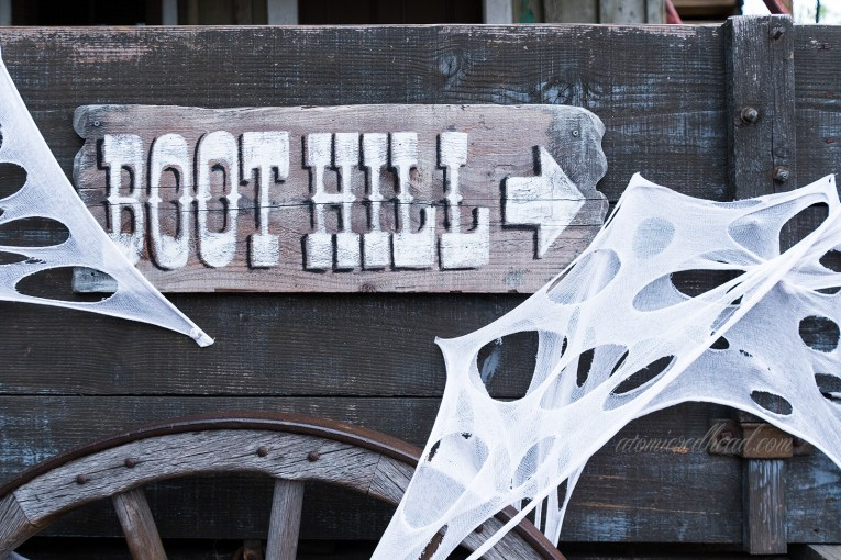 The sign directing guests to Boot Hill has cobwebs around it.