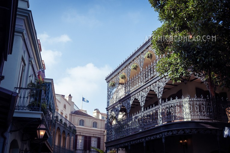 Swirling wrought iron balconies along the streets of New Orleans Square.