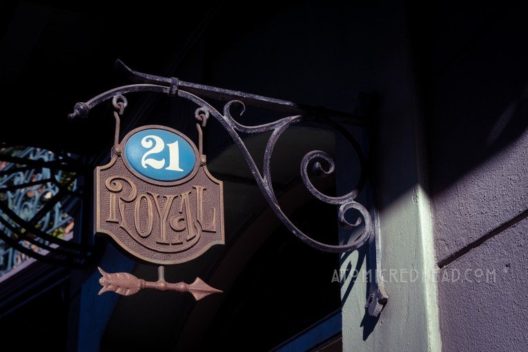 "A metal sign reads ""21 Royal"" and an arrow points the way."