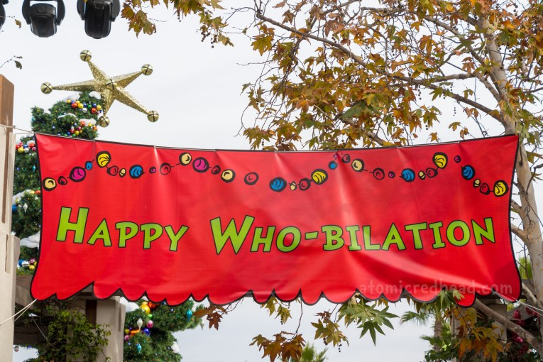 "A massive red banner reads ""Happy Who-Bilation"""