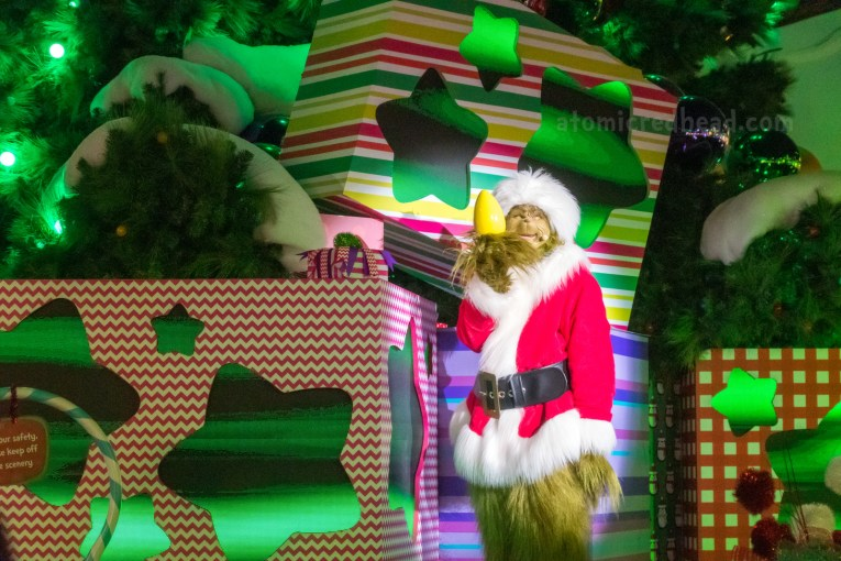 The Grinch steals a lightbulb from the tree in a recreation of his story.