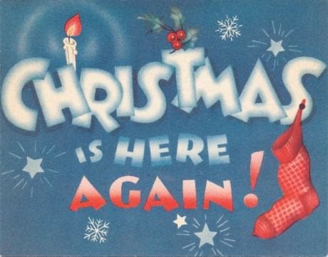 "On a blue background red and white text reads ""Christmas is Here Again!"" A red stocking hangs from the S"