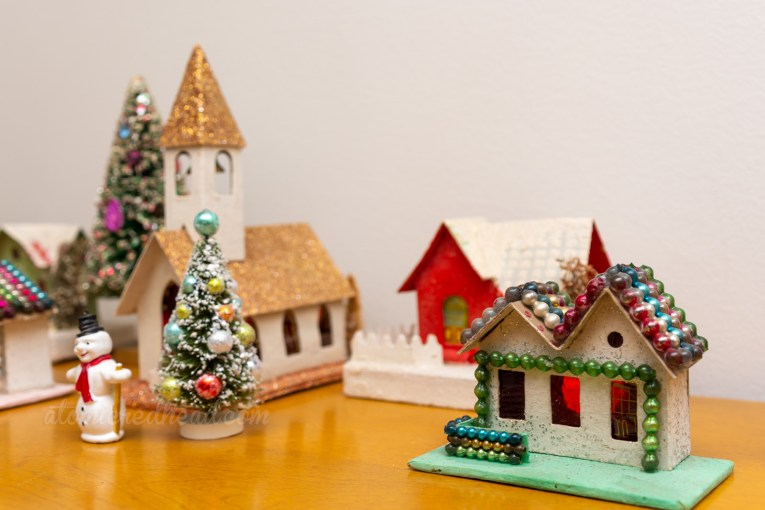 Close-up of some of the vintage cardboard houses that sit on the secretary.