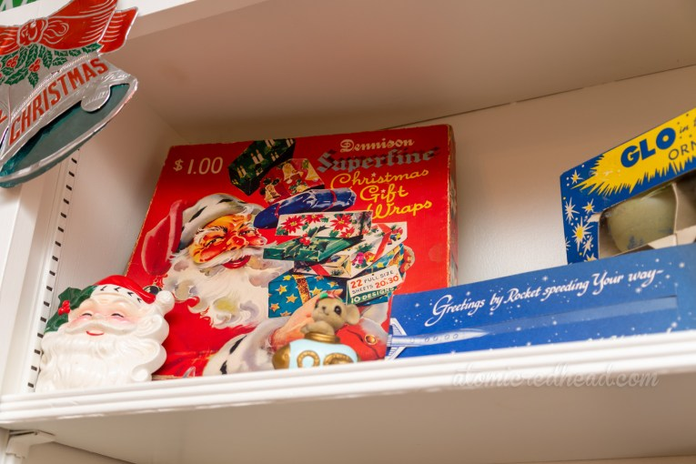 Close-up of a vintage box for Christmas wrapping paper, which features an illustration of Santa.