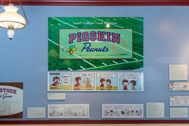 A sign for the Pigskin Peanuts display inside Town Hall. Various football strips are hung on the wall.