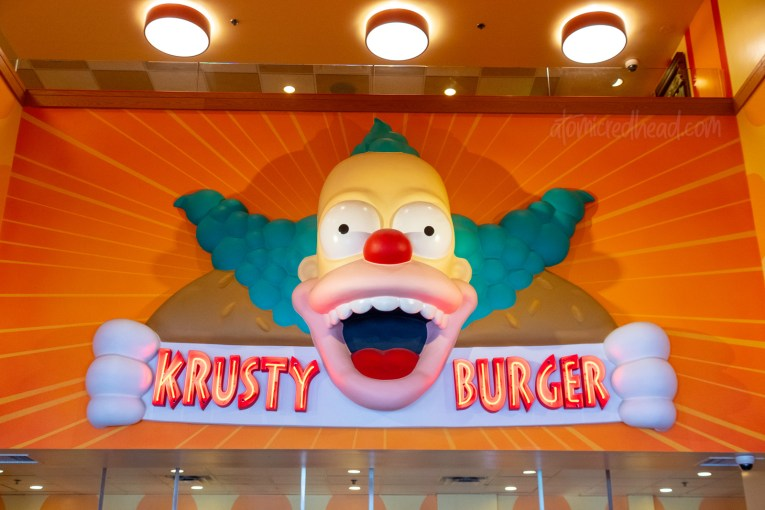 Inside Krusty Burger, a massive head of Krusty the Klown beckons visitors.