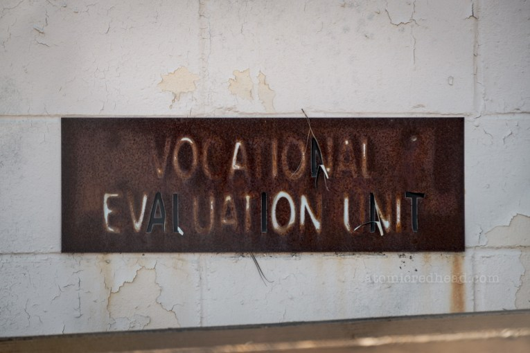 "A fading sign reads ""Vocational Evaluation Unit"""