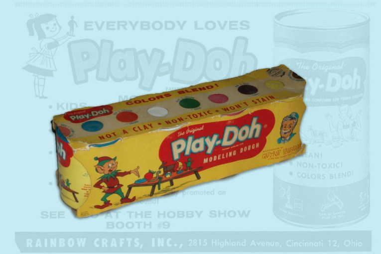 A teal background features a Play-Doh ad, vibrant in the center is a colorful pack of Play-Doh.