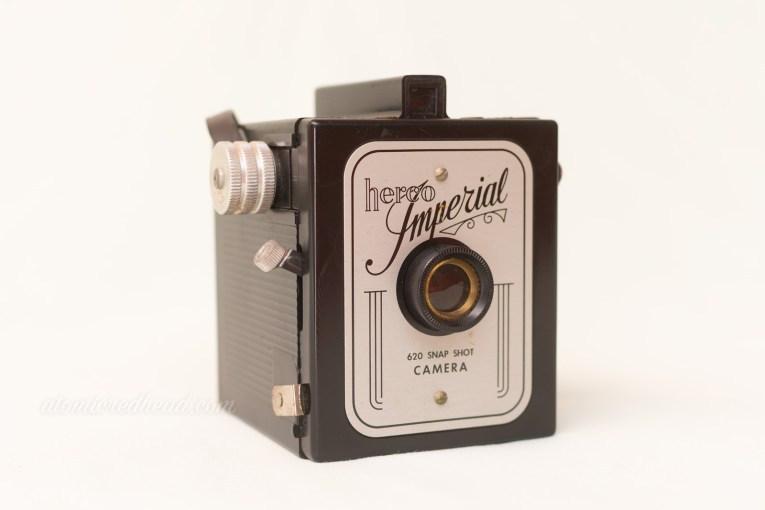 "Herco Imperial. A small square camera with a silver front. A scrolling script reads ""Imperial"" across the top."