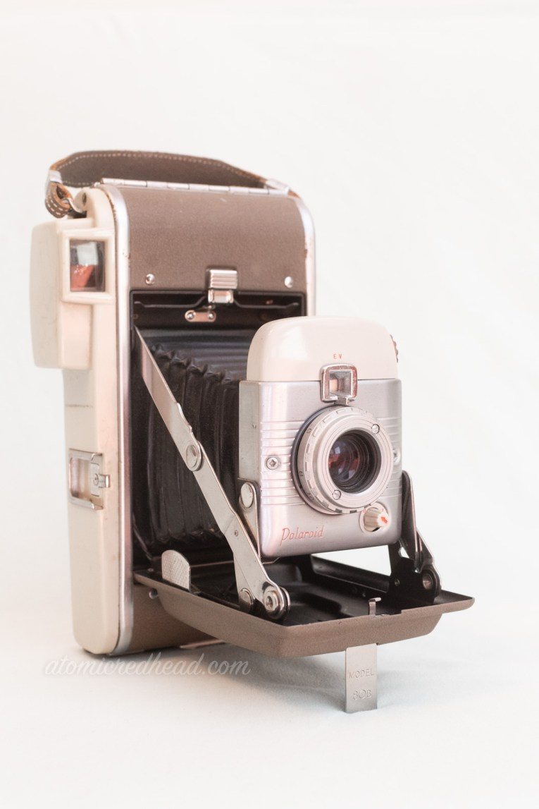 Polaroid Model 80B. A two tone silver camera with a bellows.