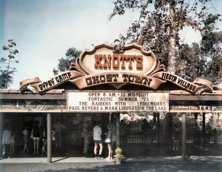 "Entrance to Knott's Berry Farm, which features the ""Old Timer"" at the top of the sign."