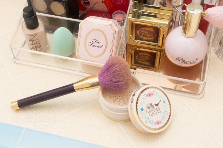 A make-up brush sits on my powder box.