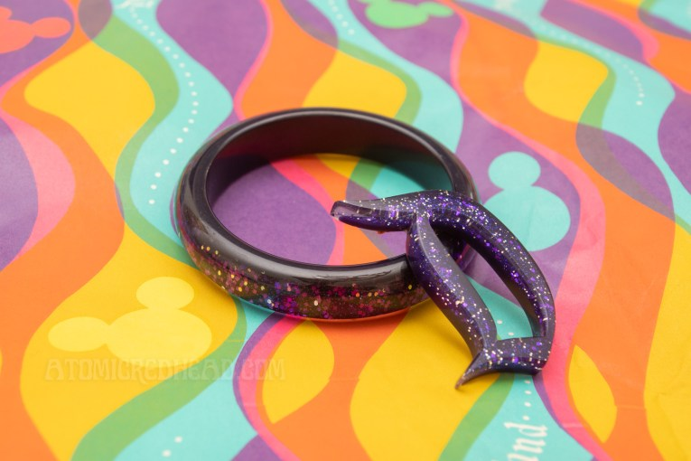 A matching purple glitter bangle and D brooch.