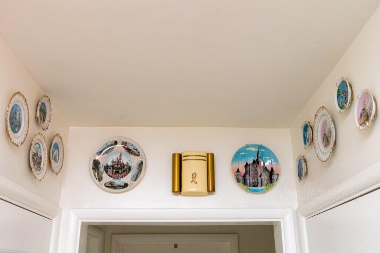 Various vintage Disneyland plates hang above three doorways.