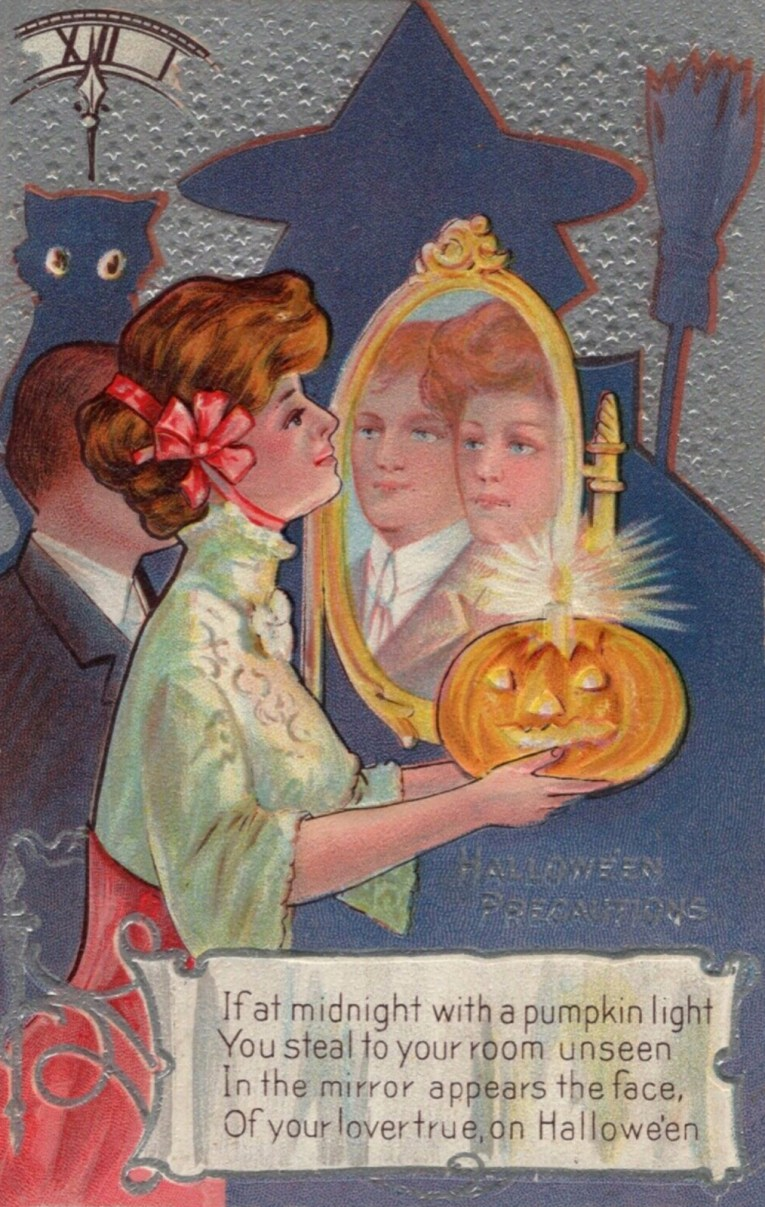 "A woman in a red and white outfit holds a Jack O'lantern with a candle at the top in front of a mirror. A man stands next to her and appears in the mirror next to her. Text reads ""Halloween Precautions If at midnight with a pumpkin light You steal to your room unseen In the mirror appears the face, Of your lover true, on Halloween."""