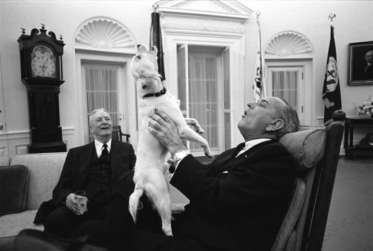 President Johnson howls with Yuki in the Oval Office.