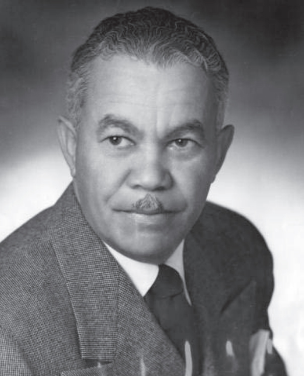 Black and white photograph of Paul Revere Williams, a dapper gentleman in a suit with a small mustache.