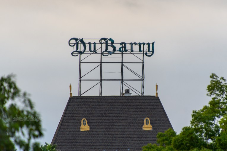 """In gothic script rising above a roofline reads """"DuBarry"""""""