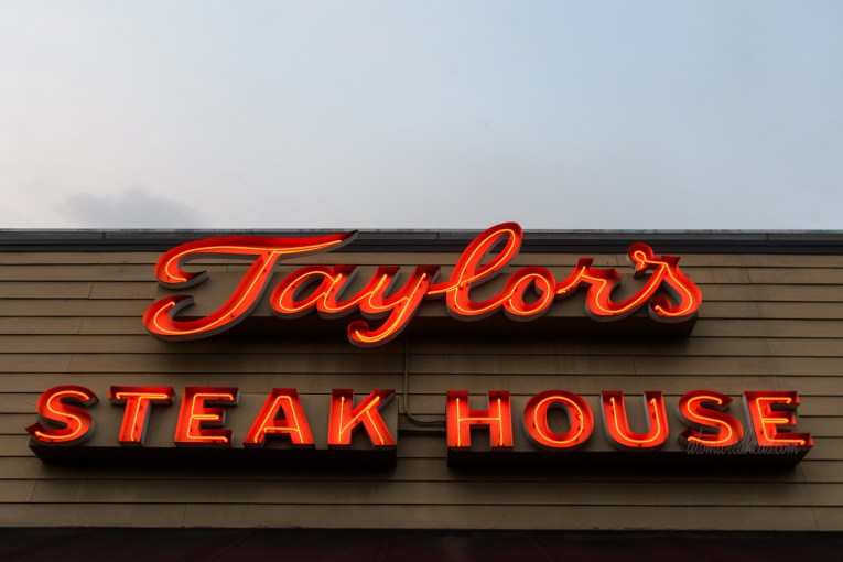 """Red neon spells out """"Taylor's Steak House"""""""