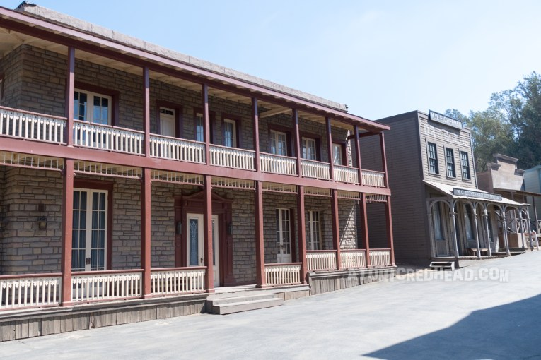 The stone building as it appears on the backlot, with the same maroon trim.