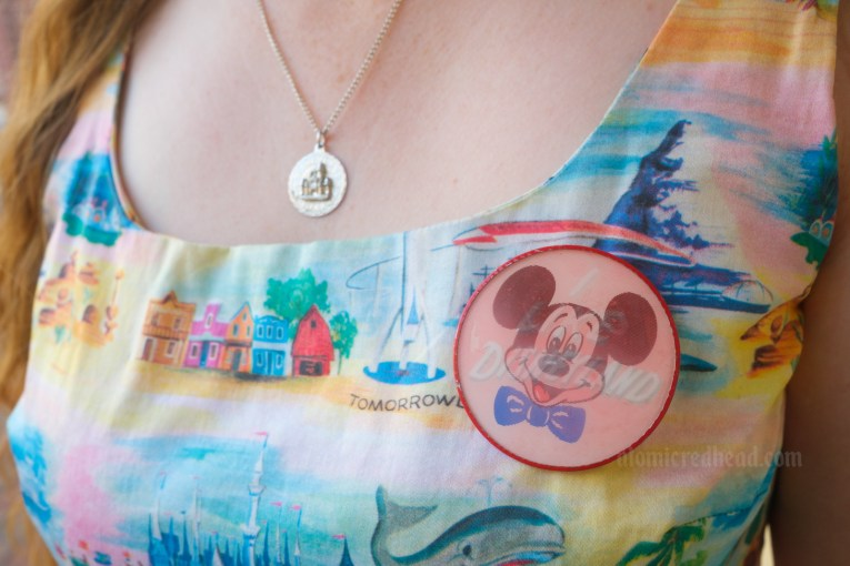 """Close-up of a vintage button I wore, which feature's Mickey's face, and when viewed another way reads """"I like Disneyland!"""""""