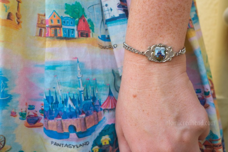 Close-up of my charm bracelet, which features an enamel image of the castle.