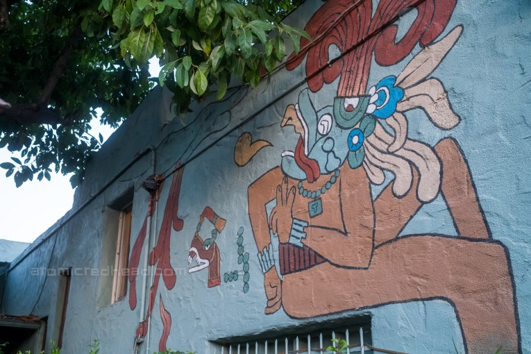 A colorful god painted on the walls of the courtyard.