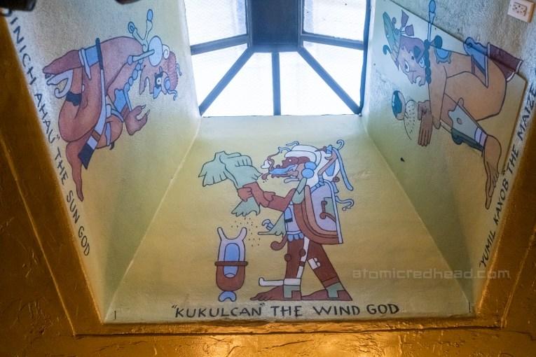 Various gods painted near a skylight.