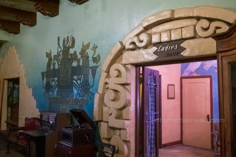 Doorway to the ladies lounge, which features Mayan details in a circular design around the doorway, and a mural of the god of lust painted next to it.