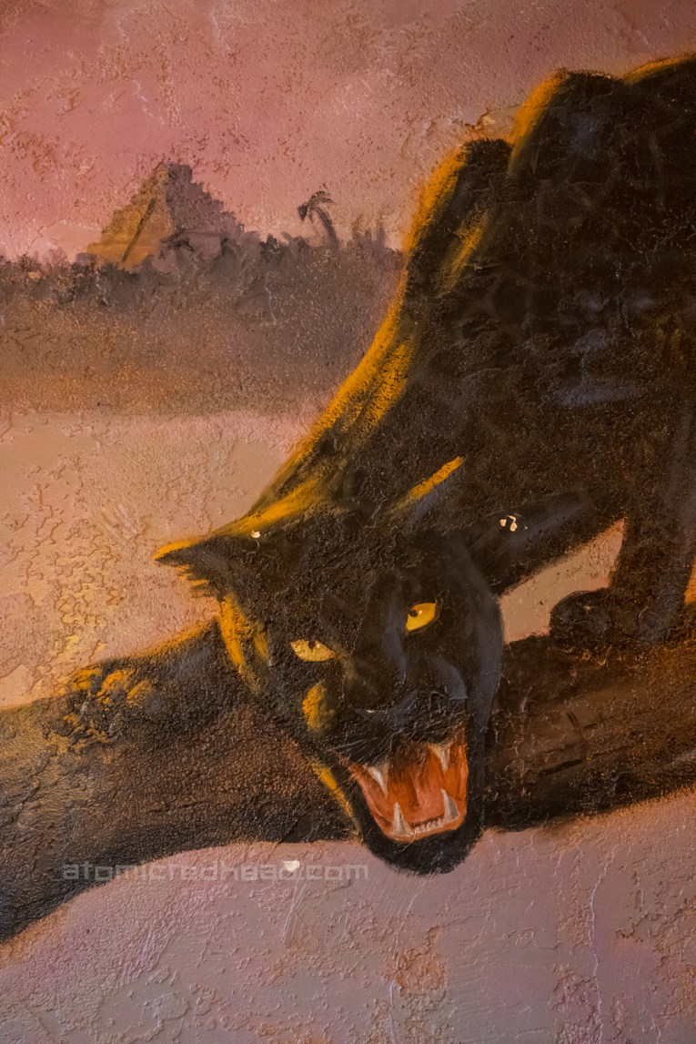 Mural of a black panther painted on the walls of the restaurant.