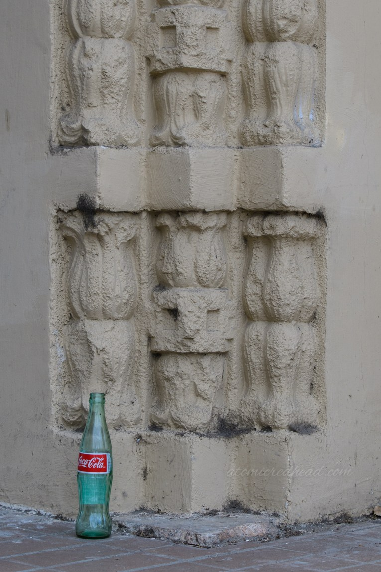 Close-up of the details by the front door, along with an empty Coca-Cola bottle.