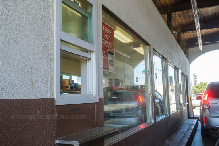 A variety of windows inside The Donut Hole for customers to order, see the donuts available, and pay.