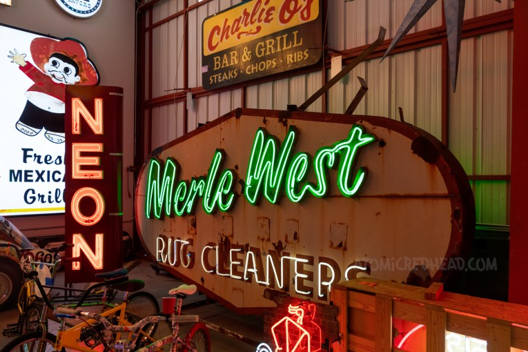 """Neon sign reads """"Merle West Rug Cleaners"""""""
