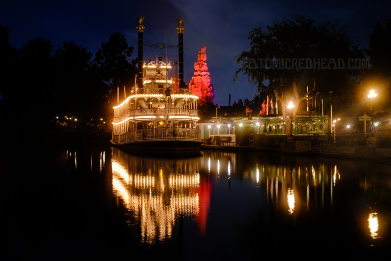 The Mark Twain riverboat sits docked in Frontierland.