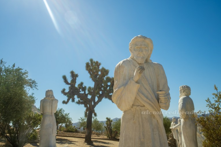 A row of giant white washed statues.