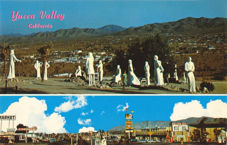 """Vintage postcard, featuring an overview of the giant white washed statues of Desert Christ Park on top, below a street view of Yucca Valley. Red script in the upper left reads """"Yucca Valley, California"""""""
