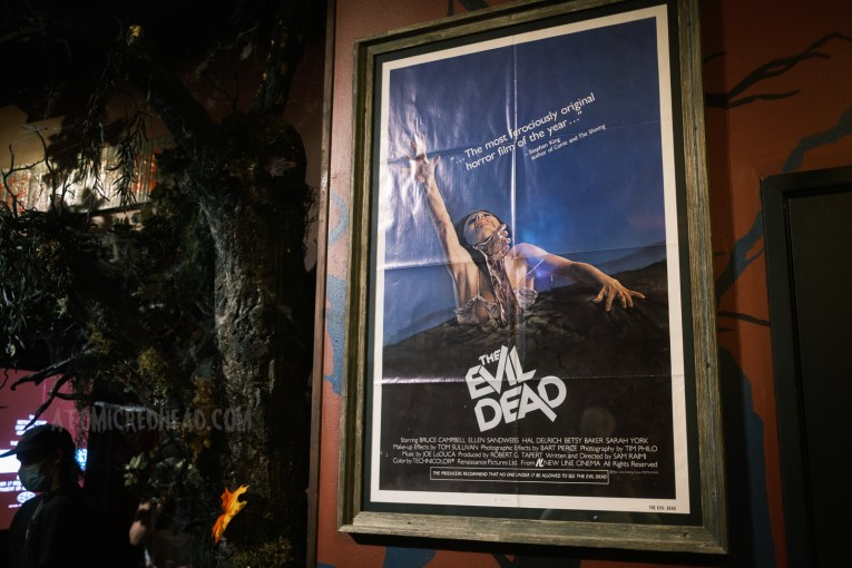 Original poster for The Evil Dead, which features a woman reaching into the air as she is dragged down by a disturbing, zombie like hand.