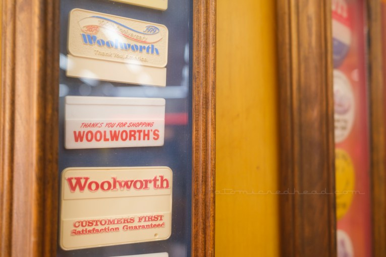 Close-up of a framed set of Woolworth's name badges.
