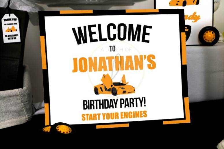 Orange supercar party welcome sign