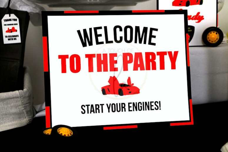 Red exotic car party welcome sign