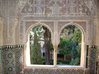 We could peek through archways and windows to green peaceful courtyards.