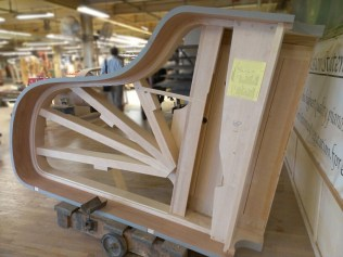 Rims are made of several layers of hard rock maple. The wood is shaped on a press patented by Steinway