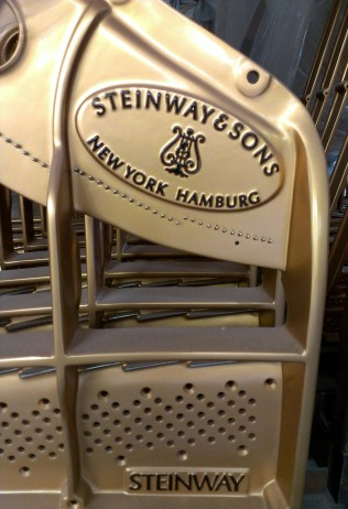 Close up of the Steinway & Sons Logo on an iron plate.