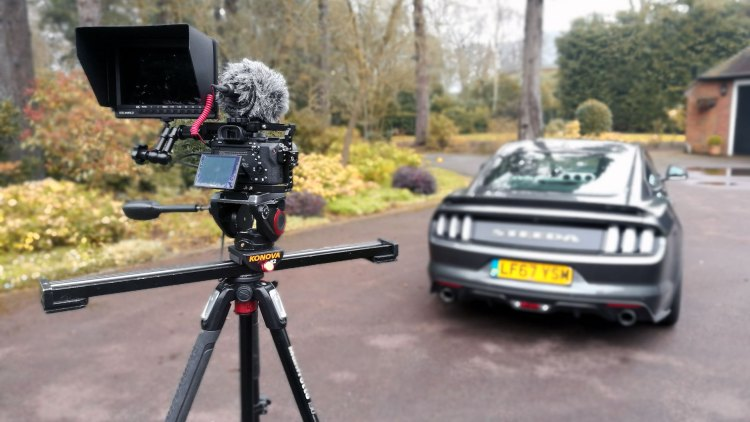 Filming a car: Steeda Mustang being captured by a Sony A7RII, Rode mic, camera cage and video slider